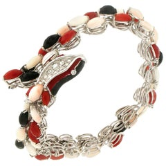 Handcraft Snake 18 Karat White Gold Diamonds Coral and Onyx Cuff Bracelet