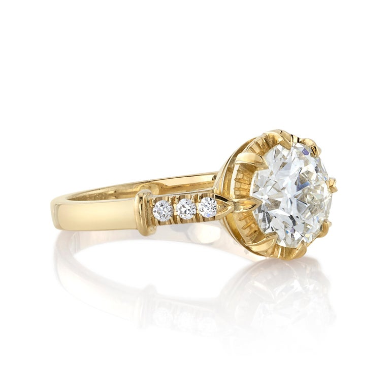 1.68ct M/VS1 GIA certified old European cut diamond with 0.09ctw old European cut accent diamonds set in a handcrafted 18K yellow gold mounting.  Ring is currently a size 6 and can be sized to fit.  Our jewelry is made locally in Los Angeles and