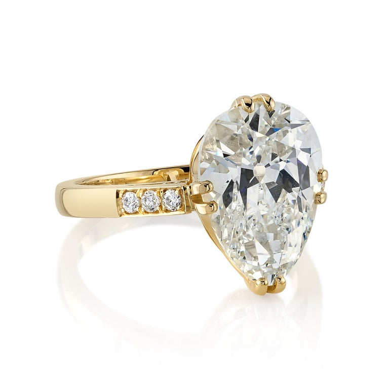 5.00ct L/VVS1 GIA certified Pear shaped diamond with 0.11ctw old European cut accent diamonds set in a handcrafted 18K yellow gold mounting.  Ring is currently a size 6 and can be sized to fit  Our jewelry is made locally in Los Angeles and most