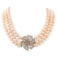 Handcrafted Beaded Coral Necklace with 18 Karat Gold and Diamonds Central Flower