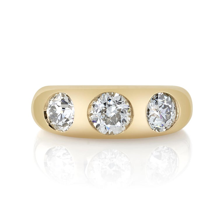 0.76ct K/SI2 GIA certified old European cut diamond with 1.27ctw old European cut accent diamonds set in a handcrafted 18K yellow gold mounting.  Ring is currently a size 6 and can be sized to fit.  Our jewelry is made locally in Los Angeles and