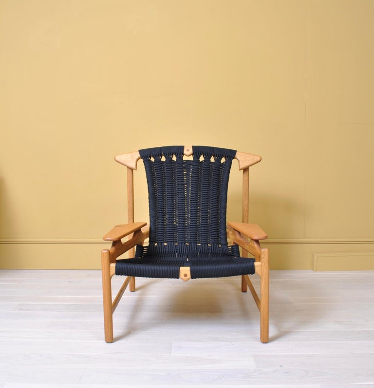 Incredible lounge chair designed and handcrafted by Danish designer maker Martin Godsk. Utilizing reclaimed European white oak to stunning effect, Martin Godsk adds softness with woven black rope upholstery. Powerful modernist statement design.