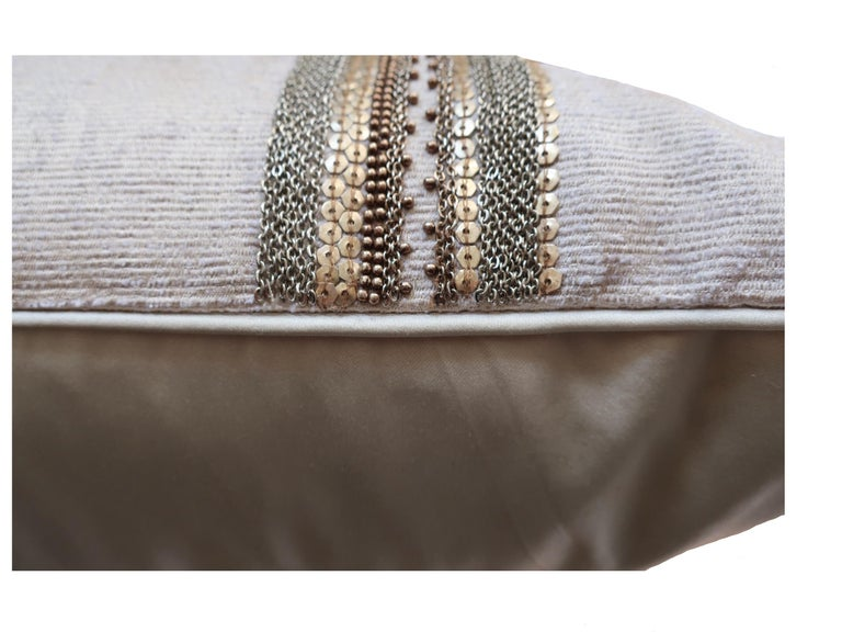Hand embroidery pillow. Pearl color grosgrain base.