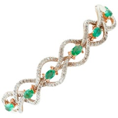 Handcrafted Emeralds and Diamonds, 9 Karat Rose Gold and Silver Retro Bracelet