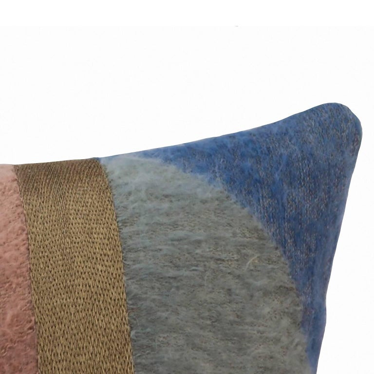 Handcrafted pillow embroidered with mohair yarn and gold metallic threads.