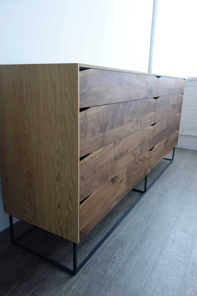 Rustic modern dresser made of select walnut and white oak with a charcoal coated steel base. Eight soft-close dovetailed drawers, four of which have removable interior dividers to keep contents separated. This super-size dresser has loads of