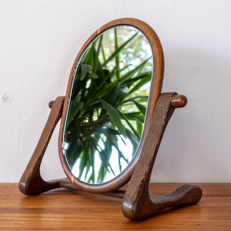 Incredible studio made mixed exotic wood table top mirror. It is crafted with wenge, maple and oak. The mirror portion pivots. Unsigned 1960s.