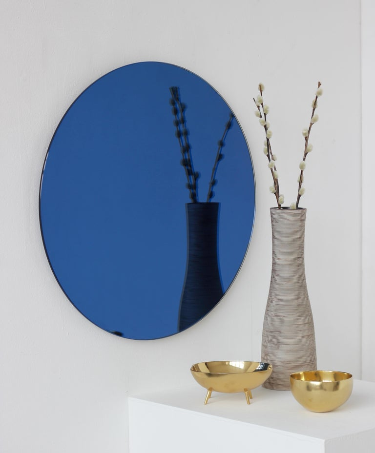 Delightful crafted blue tinted round Orbis™ mirror frameless with a floating effect. Designed and hand-crafted in London UK. 