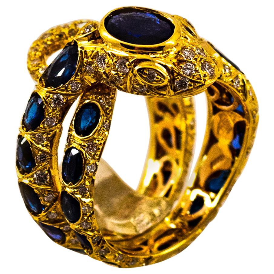 """Handcrafted Modern White Diamond Blue Sapphire Yellow Gold Cocktail """"Snake"""" Ring"""