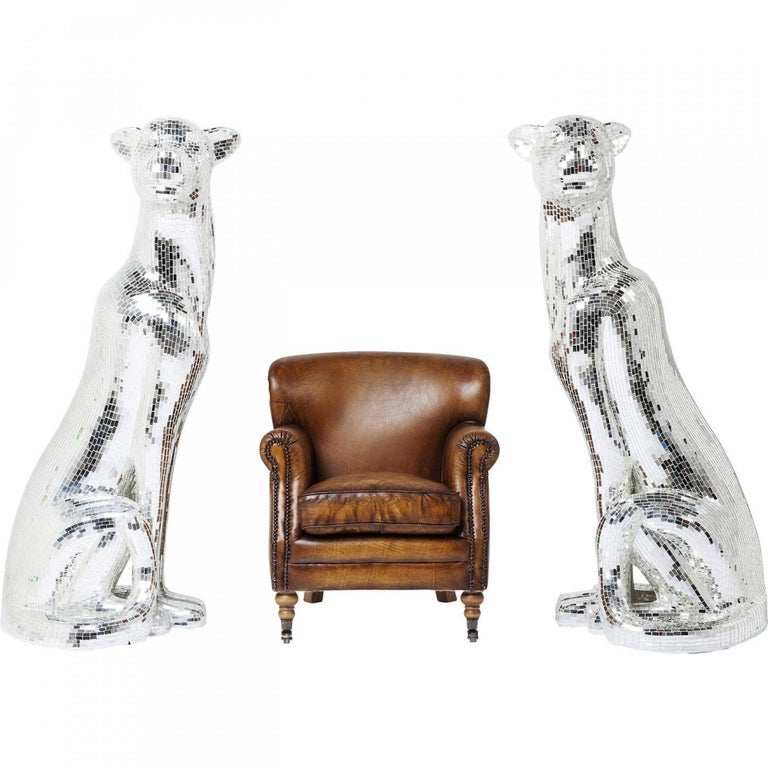 An eye-catching, fascinating figurine in the form of a panther. Made of mirrored glass mosaic, this piece glitters elegantly from every perspective.   A remarkable accent piece inspired by the sleek beauty of big cats, the four-legged monster statue