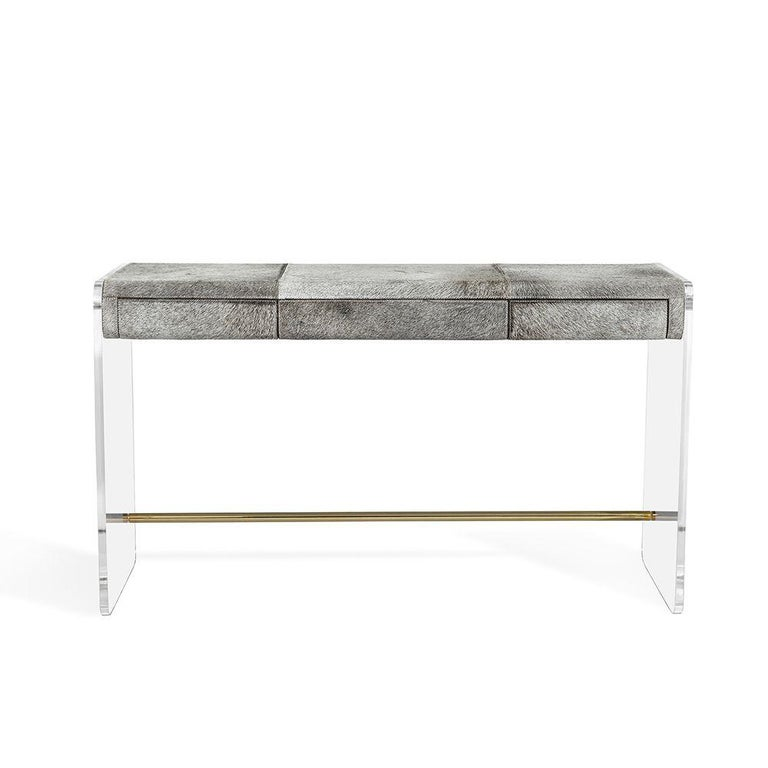 Contemporary chic desk featuring sleek acrylic base topped with natural grey hide. Hide is a natural material and variations in coloration are to be expected and it will add to the uniqueness and charm of each piece. Desk comes with 3 drawers and