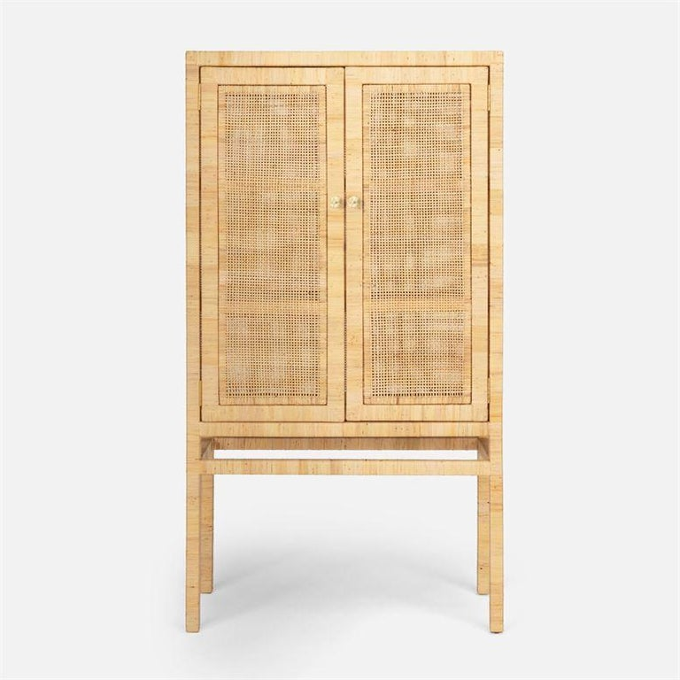A 100% natural peeled rattan weave structure with tightly wrapped natural rattan edges that matches the cabinet's exterior. Fitted with 2 interior shelves. The rattan allows for the interior to stay ventilated. Dimensions: 36