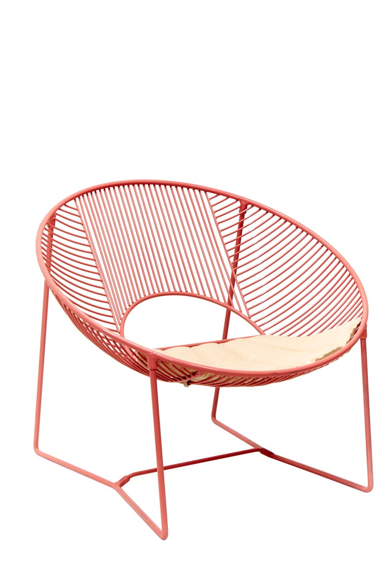 This outdoor lounge chair is a unique creation by León León Design from Mexico City. It features a solid powder-coated steel structure and can be used either indoor or outdoor.  Handcrafted in small batches, every chair comes with a hand-numbered