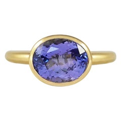 Handcrafted Oval Cut 4.70 Carats Tanzanite 18 Karat Yellow Gold Cocktail Ring