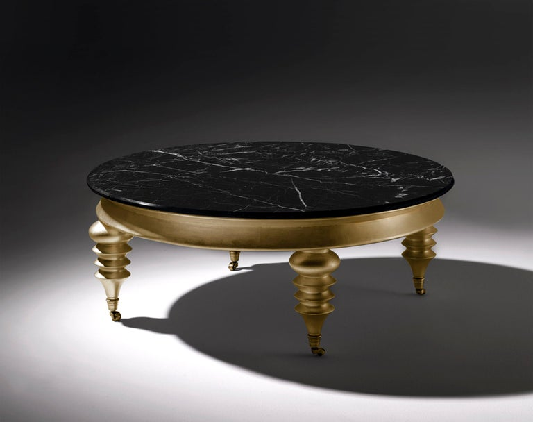 Rolling Gold Round Coffee Table With Black Marble Top And