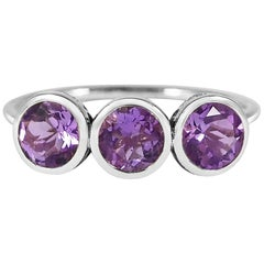 Handcrafted Round Cut 0.45 Carat Amethysts 18 Karat White Gold Three-Stone Ring