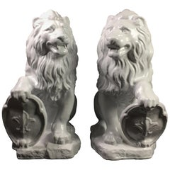 Handed Pair of Bisque Terracotta Conservatory Lion Ornaments