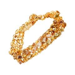 Handmade 18 Karat Gold and Fancy Color Diamond Bracelet. 99 Diamonds 21.25 Carat