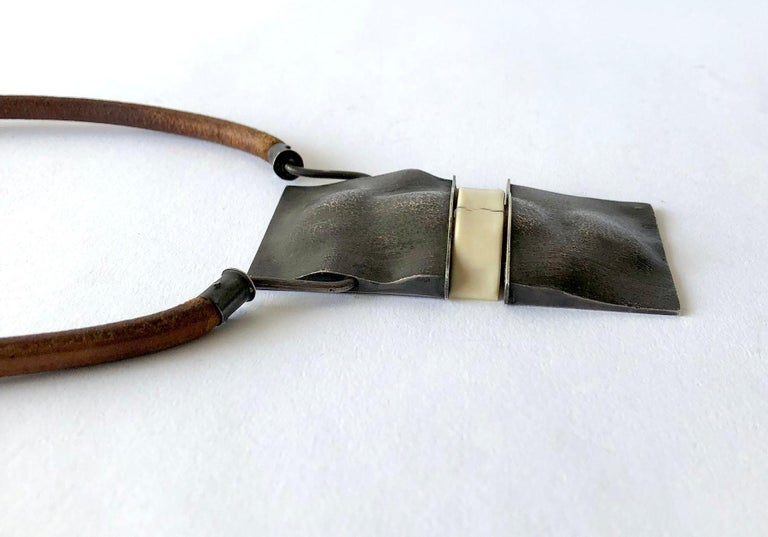 One of a kind 1970's silver pendant on leather necklace with handmade silver closure.  Hinged pendant measures 3.75