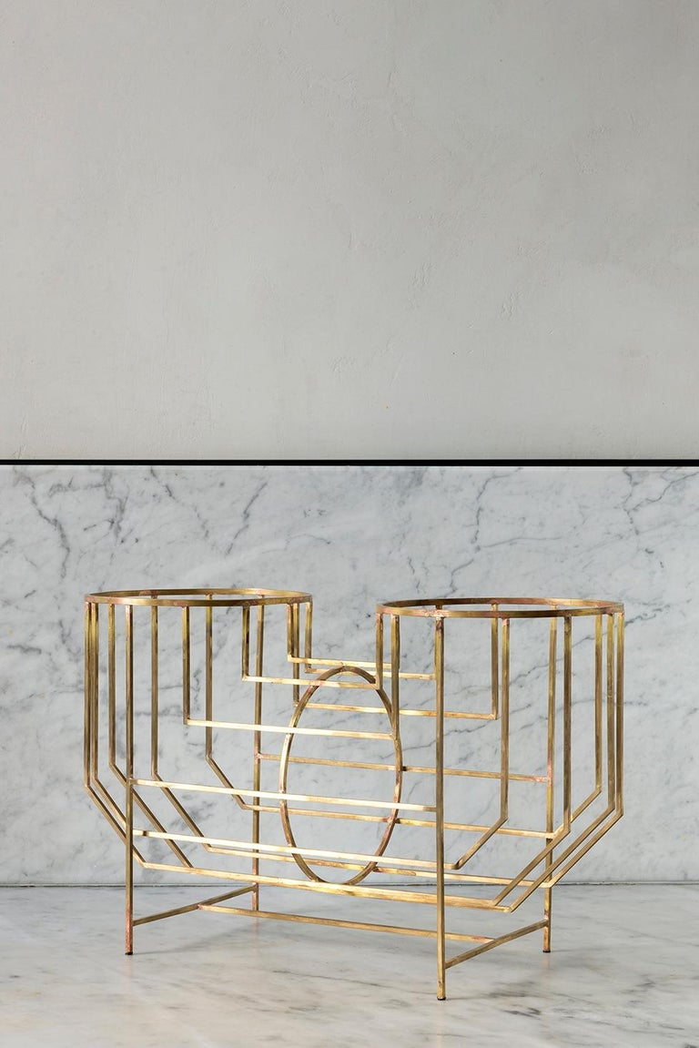 The juxtaposition of multiple linear elements creates the tube frame. A permeable structure, which relates the container to the content.  This item is entirely handmade, it is a one-piece, some minor imperfection may be present due to the hand
