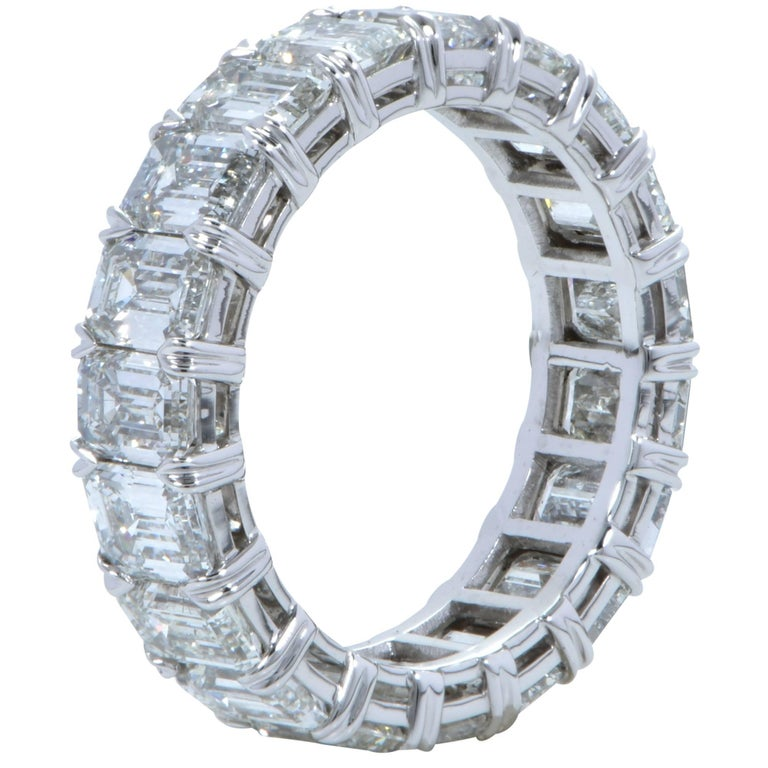 Platinum handmade band size 6. Featuring 19 emerald cut diamonds weighing 6.29cts total G-H color VVS-VS1 clarity. Size 6  Our pieces are all accompanied by an appraisal performed by one of our in-house GIA Graduates. They are also accompanied by