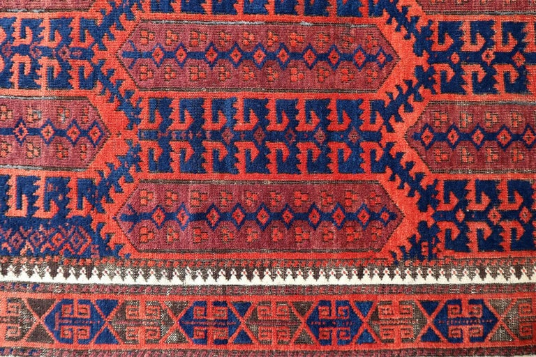 Handmade antique Baluch rug from Afghanistan in original condition, it has some signs of age. The rug is from the beginning of 20th century.  - Condition: Original, some signs of age,  - circa 1900s,  - Size: 2.9' x 5.3' (90cm x 163cm),  -
