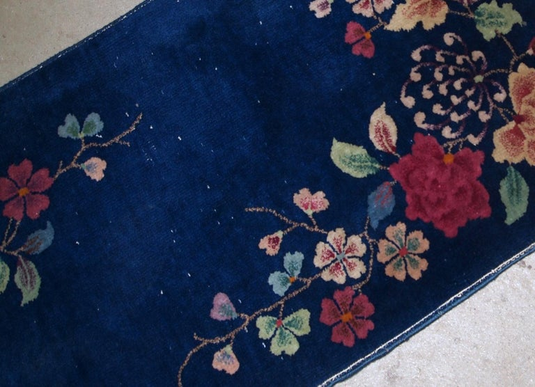 Hand made antique Art Deco Chinese rug in deep blue shade. The rug is in original condition, has some low pile.  -condition: original, some low pile,  -circa: 1920s,  -size: 2.1' x 4.1' (64cm x 125cm),  -material: wool,  -country of origin: