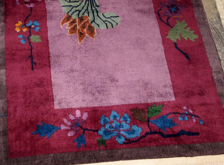 Handmade antique Art Deco Chinese rug in purple shade. The rug has some bright shades of green, blue and brown as well. It is in original good condition.   - Condition: Original good,  - circa 1920s,  - Size: 2.7' x 4.4' (82 cm x 134 cm),  -