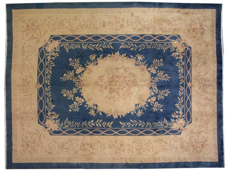 Handmade antique Chinese rug in original good condition. The rug is made in French Aubusson style with soft beige and peach shades. The rug is very heavy (around 50kg, 90 lbs) so it will lay on the floor steady.