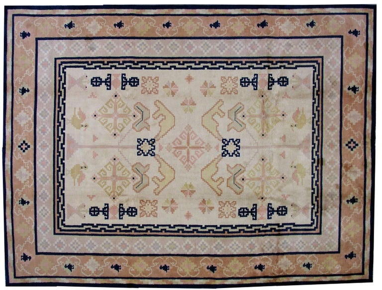 Antique Fete Chinese rug in original condition. The rug made in in soft pastel shades of peach, purple, beige and yellow, strong navy blue color is very contrasted on the details of the rug. The pattern on the rug is geometric which is quite unusual