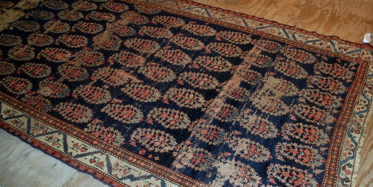 Handmade antique Northwest rug in original condition. This runner is collectible, has been made in the beginning of 19th century  -condition: distressed,  -circa 1830s,  -size: 5.2' x 10.7' (158cm x 326cm),  -material: wool,  -country of