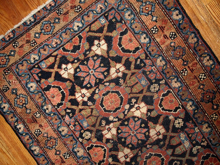 Antique Hamadan style runner 3' x 13' (91cm x 396cm) in good original condition. This rug is in black and red shades.