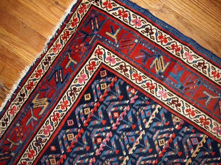 Antique hand made Kurdish style distressed runner 3.4'x12.3' (103cmx375cm) in dark blue shade. The rug has some age damages and a patch.