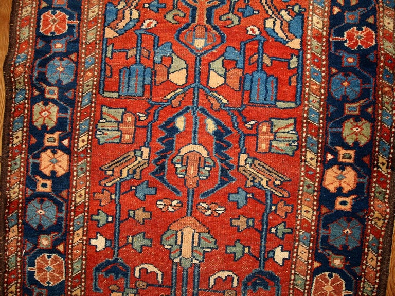 Antique Lilihan style rug in red and blue colours. This runner is from the beginning of 20th century in original good condition. Measures: 3.3' x 10.2' (100cm x 310cm).