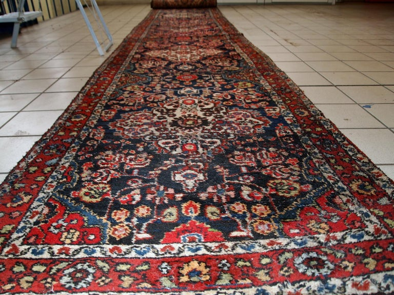 Handmade antique Persian Malayer runner in original good condition. The rug is from the beginning of 20th century, made in wool.  - Condition: original good,  - circa 1920s,  - Size: 2.8' x 17.6' (86cm x 536cm),  - Material: wool,  -