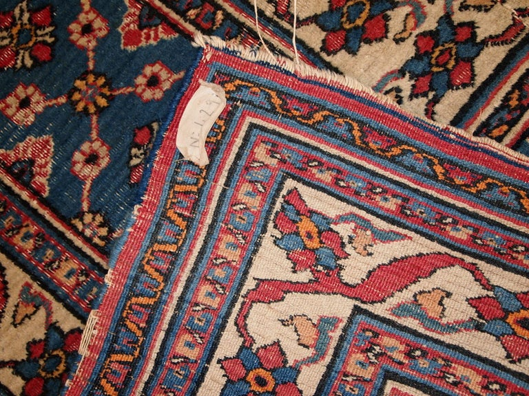 Handmade antique Persian Mashad runner in original condition. All-over design, split in two parts. The shade of blue is changing from one side to another from darker to lighter. It is in distressed condition.  - Condition: original,