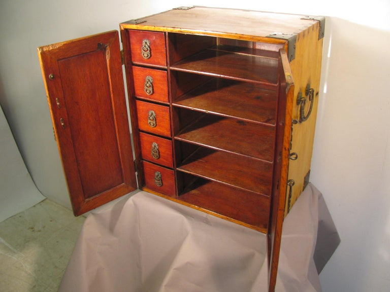 Entirely handmade cabinet, hand wrought and hammered metal hardware. Cabinet is entirely dovetailed and splined. Can be used as a end table, or even mounted on a wall. Interior boxes are 10.5 x 4 x 3 H.