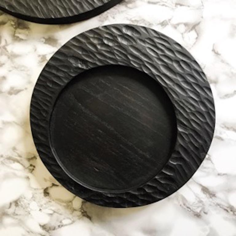 Hand carved wood from one of the mother countries, Portugal, these beautiful pieces for your table will add a rustic yet modern touch. Wood is Portuguese chestnut, expertly crafted by a third generation master wood carver. The black stained wood is
