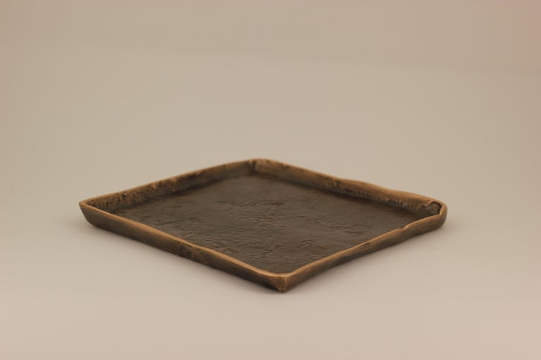 Graceful bronze tray, vide-poche, inspired by Wabi-Sabi, the ancient Japanese philosophy that views and embraces the world for its imperfections and transient nature. It translates into an exquisite aesthetic that is imperfect and incomplete, yet