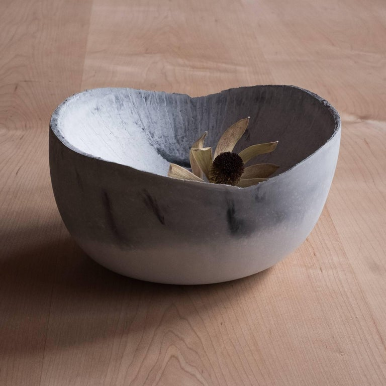 A collection of 236 unique bowls, the Concrete Series by UMÉ Studio expresses the tension between heavy concrete and its delicate edge generated by hand pouring. While one assumes concrete should be strong and durable, it is, at its core, fragile.
