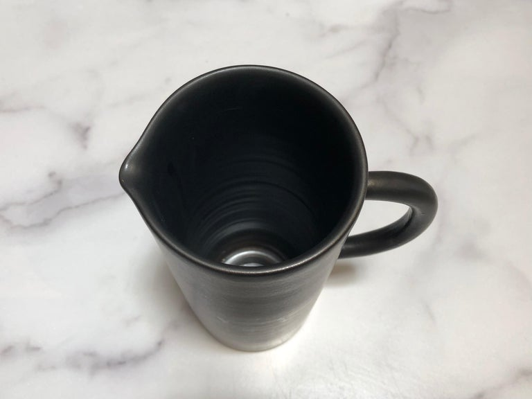 Handmade and hand painted ceramics from one of the mother countries, Portugal, these beautiful pieces for your table will add a modern touch and are perfect to mix and match. This pitcher comes in black or white.