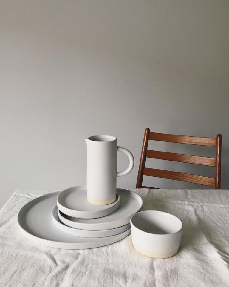 """Handmade and hand painted ceramics from one of the mother countries, Portugal, these beautiful pieces for your table will add a modern touch and are perfect to mix and match. This pitcher comes in black or white.  Size: 8"""" height, 4"""""""