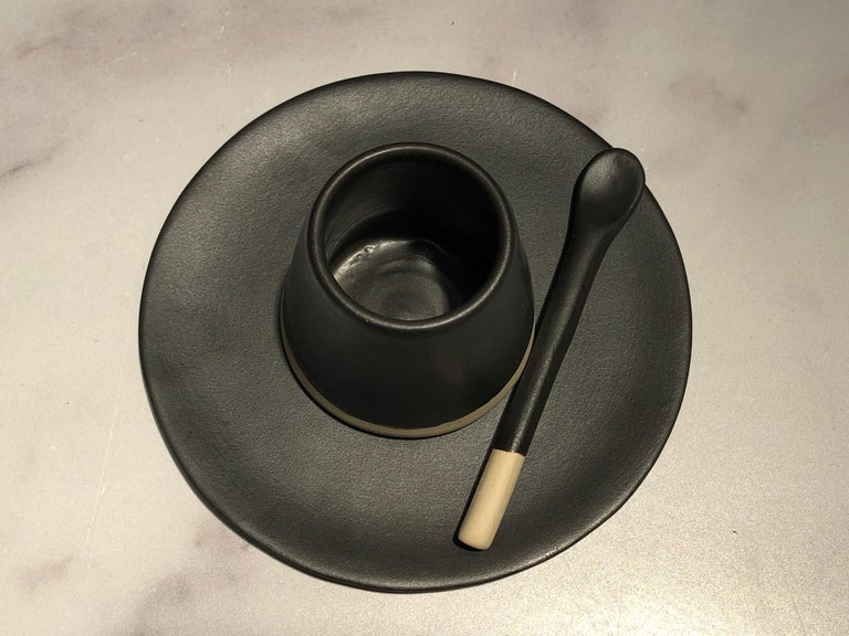 """Handmade and hand painted ceramics from one of the mother countries, Portugal, these beautiful pieces for your table will add a modern touch and are perfect to mix and match. This matte-glazed saucer is available in black or white.  Size: 5"""""""