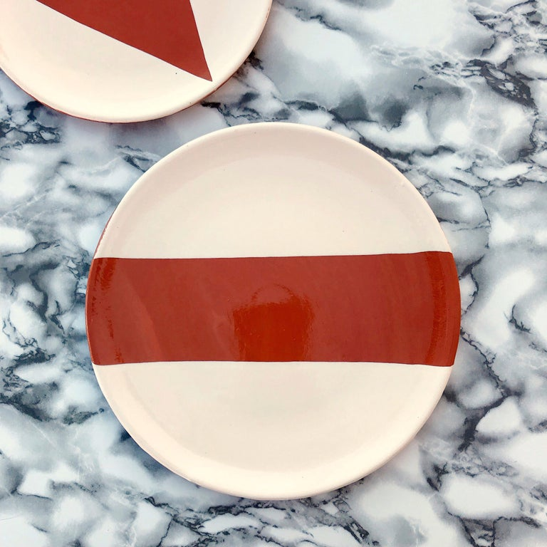 Handmade and hand painted ceramics from one of the mother countries, Portugal, these beautiful pieces for your table will add a modern and graphic touch and are perfect to mix and match.   Sizes: 10.6