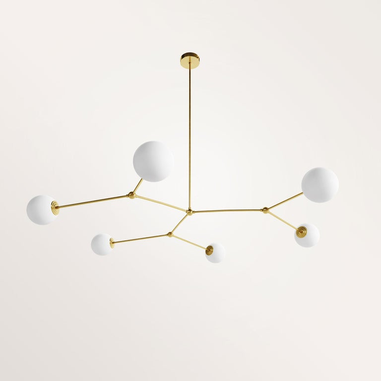 Handmade chione chandelier by Gobo Lights Dimensions: 135 L x 135 L x 100 H Materials: Brass, opaline  Chione is a goddess, daughter of Boreas. She is associated to the winter.  Self-taught and from the world of chemistry, this Belgian