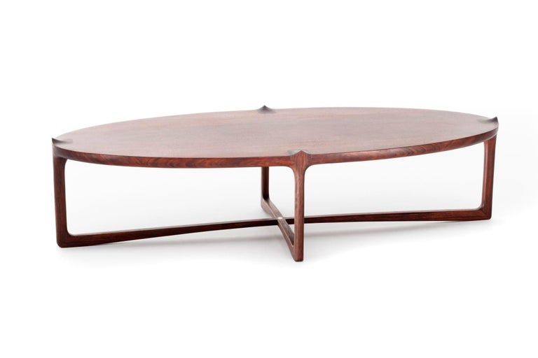 This hardwood coffee table in a contemporary Brazilian design is part of the Sahara collection (that comprises the tables Emi and Kou) was designed after long days trying to portray the calm and breathtaking landscape of the farms and wheat