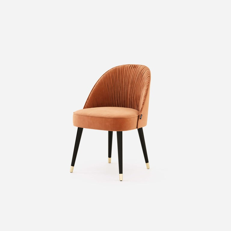 The contemporary dining chairs hold a stimulating design, as they hold an elegant combination of handmade couture techniques, wood, and metal. Their shapes are inspired by the unique French couture and each detail will elegantly flow inside of an