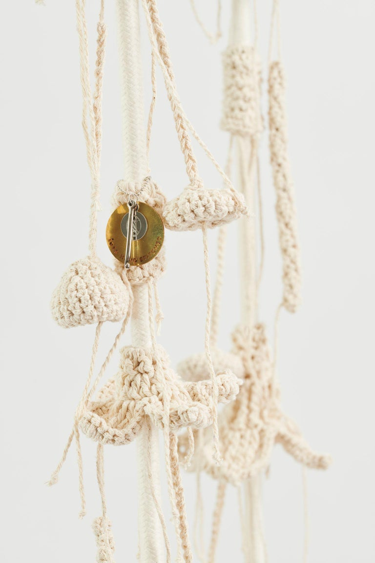 The iota desert swing, influenced by desert aesthetics, takes the user to a wild, natural, fantastic place. The swing showcases much of our special knitted hand work. The numerous intricate elements that form the swing are hand knit with bespoke