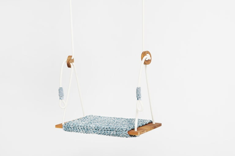 The iota rug swing, inspired by tracking in the desert and the North African culture, takes the user to a wild, natural, fantastic place. The swing showcases our special knitted hand work. It contains a knitted rug covering a wooden slag, which is