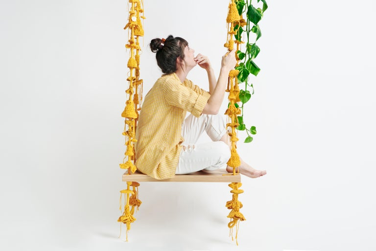 The iota sunset swing takes the user to a wild, natural, fantastic place. The swing showcases much of our special knitted hand work. The numerous intricate elements that form the swing are hand knit with bespoke yarn designed and produced